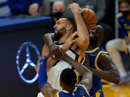 Utah Jazz centre Rudy Gobert is sandwiched between Golden State forward Draymond Green, right, and Kent Bazemore during the Warriors' win on Sunday (Jeff Chiu/AP)