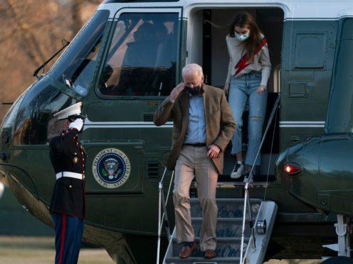 President Joe Biden, followed by his granddaughter Natalie Biden, disembarks Marine One on the South Lawn upon arrival at the White House (Manuel Balce Ceneta/AP)