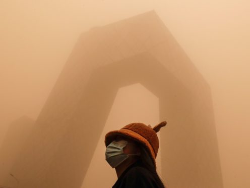 The sandstorm brought a tinted haze to Beijing's skies and sent air quality indices soaring on Monday (Andy Wong/AP)