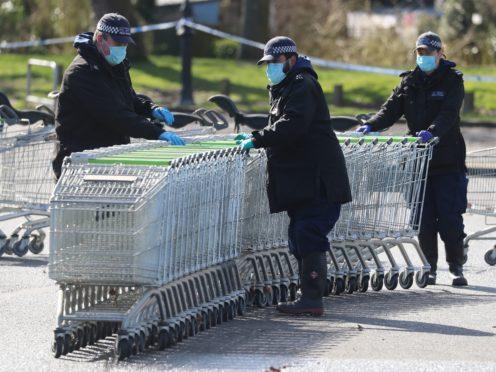 Metropolitan Police officers searching the Co-op supermarket car park in Sandwich, Kent (Gareth Fuller/PA)