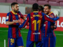 Lionel Messi (right) scored Barcelona's first and fourth goals as they climbed into second place (Joan Monfort/AP)