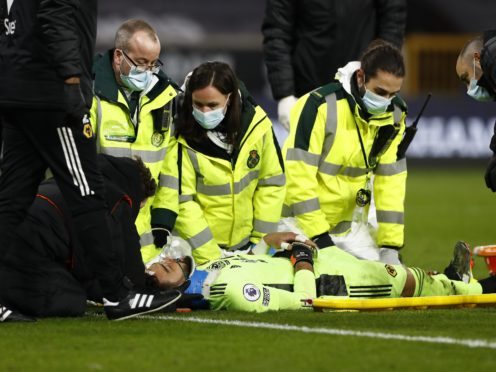 Wolves goalkeeper Rui Patricio receives treatment for a head injury against Liverpool (Jason Cairnduf/PA).