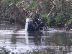 Police divers search a waterway in Sandwich, Kent, after a body found hidden in woodland at Ashford was identified as that of 33-year-old Sarah Everard (PA)