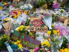 Floral tributes left next to the bandstand in Clapham Common, London, for Sarah Everard (Kirsty O'Connor/PA)