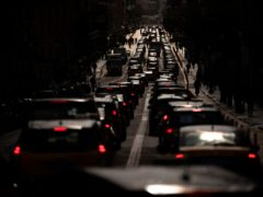 Taxi cabs move along one of the avenues in Barcelona (Emilio Morenatti/AP)