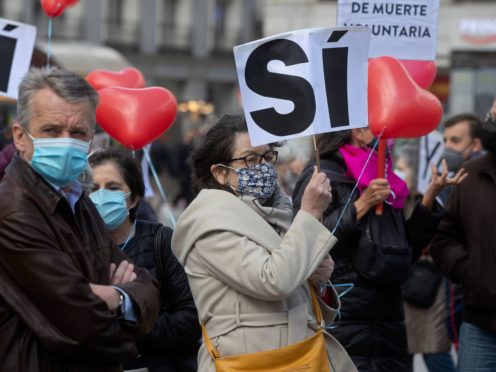 Pro-euthanasia protesters demonstrate in Madrid (Paul White/AP)