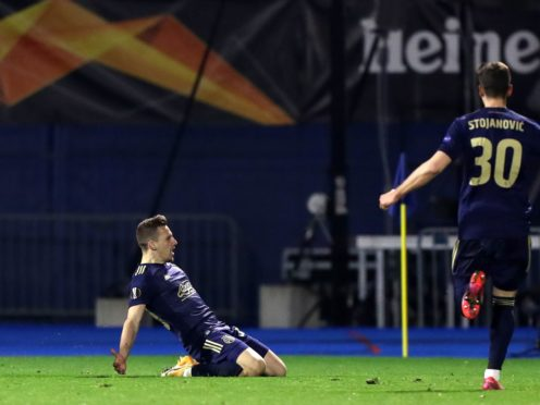 Mislav Orsic scored a hat-trick to dump Tottenham out of the Europa League (Luka Stanzl/PA)