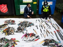 Some of the arsenal of 800 weapons, mostly knives, which have been left in weapons surrender bins in the West Midlands (Jacob King/PA)