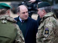 Defence Secretary Ben Wallace chats to Chief of the Defence Staff, General Sir Nick Carter (right) after a live exercise demonstration at Bovington Camp in Dorset (Andrew Matthews/PA)