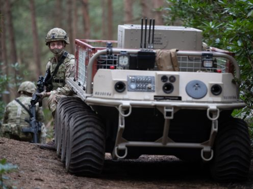 Soldiers take part in a live exercise demonstration at Bovington Camp, Dorset (Andrew Matthews/PA)