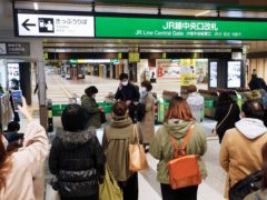 People at a train station after the quake in Japan (Kyodo News via AP)