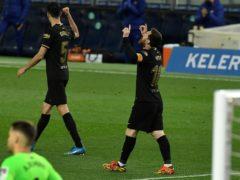 Lionel Messi celebrates scoring against Real Sociedad (Alvaro Barrientos/AP)