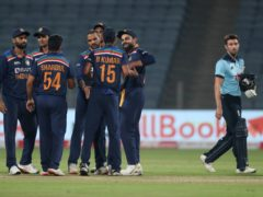 India celebrate their victory over England in the opening one-day international (Rafiq Maqbool/AP).