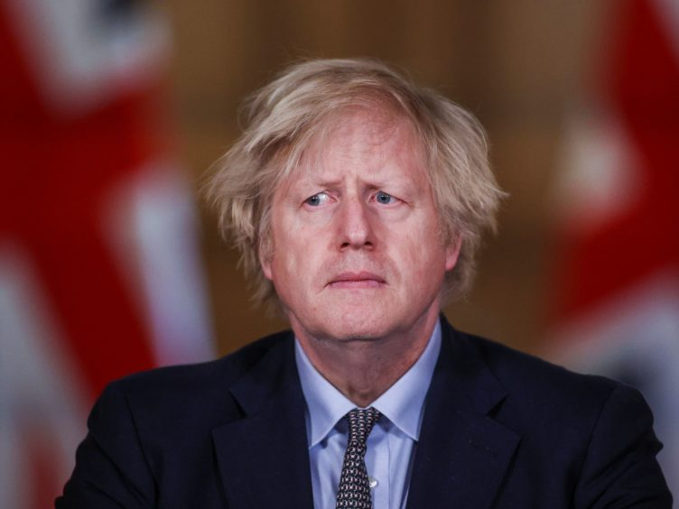 Prime Minister Boris Johnson admitted there were 'many things' could have been done differently at the start of the pandemic (Hannah McKay/PA)