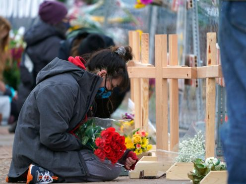 Mourners outside the King Soopers grocery store (AP)