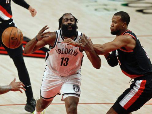 Brooklyn Nets guard James Harden (left) is fouled by Portland Trail Blazers guard Rodney Hood (Steve Dipaola/AP)