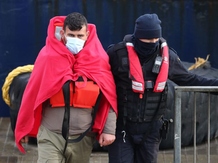 A group of people thought to be migrants are brought in to Dover, Kent. (Gareth Fuller/PA)