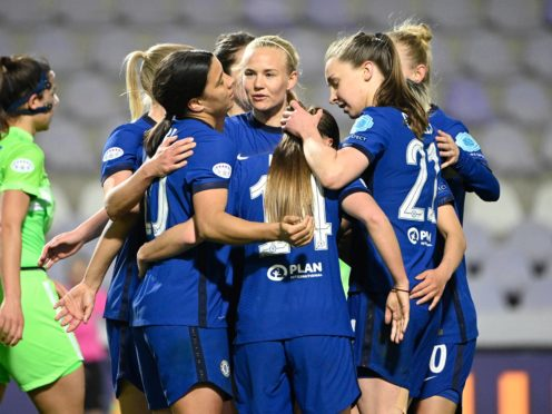 Pernille Harder is surrounded by her Chelsea team-mates after scoring (Zsolt Szigetvary/MTI via AP)