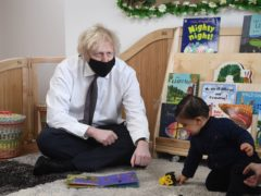 Prime Minister Boris Johnson interacts with one-year-old Sanveer during a visit to the Monkey Puzzle Nursery in Greenford, west London (Jeremy Selwyn/Evening Standard/PA)
