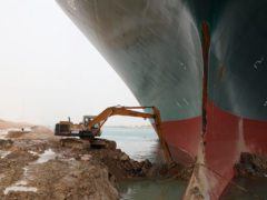 A digger tries to free the keel of the Ever Given (Suez Canal Authority/AP)