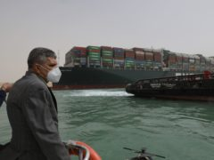 Rescuers are trying to loosen the huge container ship from the side of the Suez Canal. (Suez Canal Authority/PA)