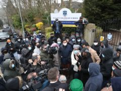 People gathered outside Batley Grammar School in Batley, West Yorkshire, for a second day of protest (Danny Lawson/PA Wire)