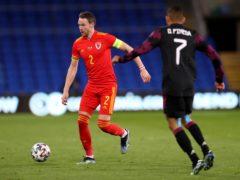 Chris Gunter (left) won his 100th cap for Wales against Mexico (David Davies/PA).