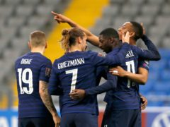 France celebrated their first World Cup qualifying victory in Kazakhstan (Stanislav Filippov/AP)