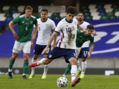 Christian Pulisic scores from the penalty spot against Northern Ireland (Liam McBurney/PA)