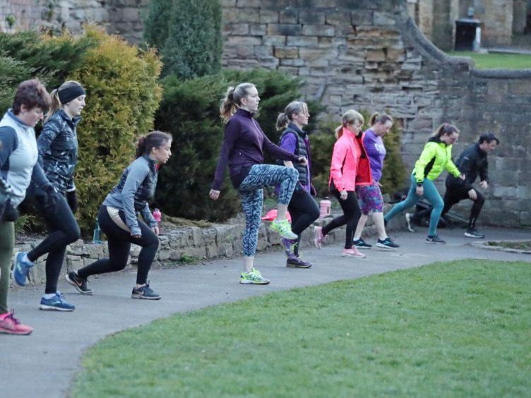 People taking part in a boot camp exercise class in Springhead Park, Rothwell, Leeds (Danny Lawson/PA)