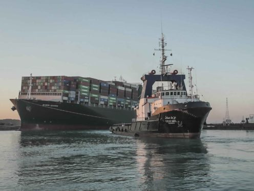 "In this photo released by Suez Canal Authority, the Ever Given, a Panama-flagged cargo ship is pulled by one of the Suez Canal tugboats, in the Suez Canal, Egypt, Monday, March 29, 2021. Engineers on Monday ""partially refloated "" the colossal container ship that continues to block traffic through the Suez Canal, authorities said, without providing further details about when the vessel would be set free. (Suez Canal Authority via AP)"