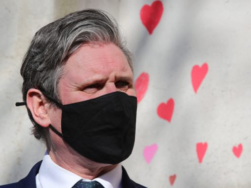 Labour Party leader Keir Starmer visits the Covid-19 memorial wall (Aaron Chown/PA)