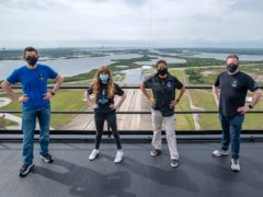 In this photo provided by SpaceX, Jared Isaacman, from left to right, Hayley Arceneaux, Sian Proctor and Chris Sembroski pose for a photo, Monday, March 29, 2021, from the SpaceX launch tower at NASA's Kennedy Space Center at Cape Canaveral, Fla. (SpaceX via AP)