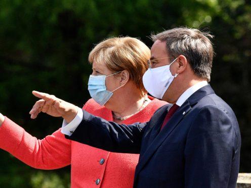 German chancellor Angela Merkel, left, and her successor as chairman of the Christian Democratic Union Armin Laschet (Martin Meissner/AP)