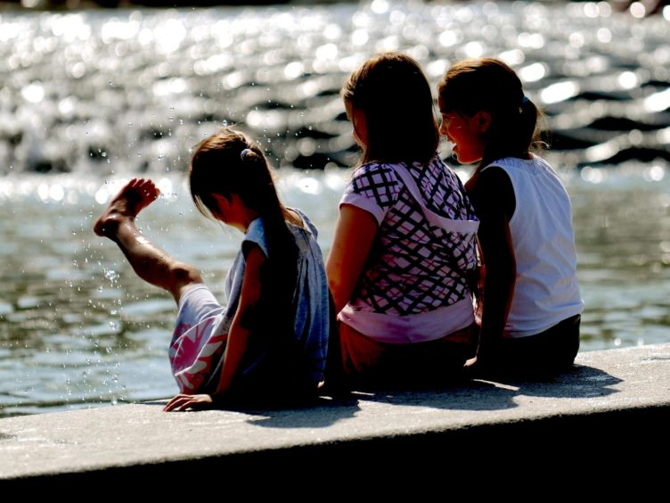 John Swinney said an 'enhanced range of summer activities' will be offered to children this year following the disruption caused by coronavirus (Anthony Devlin/PA)