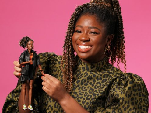 Clara Amfo holding a Barbie doll created in her likeness (Michael Bowles/Mattel/PA)