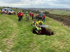 Rescuers pull a casualty from a 60ft sinkhole (Cumbria Fire and Rescue Service/PA)