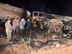 The site where a bus overturned in southern Egypt (Assiut Governorate media office via AP)