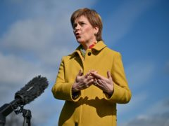 Nicola Sturgeon pledged she would not 'pass the buck' on tackling climate change to the younger generation (Jeff J Mitchell/PA)
