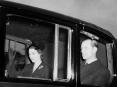 The new Queen returns to Clarence House with the Duke of Edinburgh after the sudden death of her father, King George VI (PA)