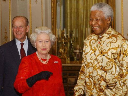The Queen and Duke of Edinburgh meet former South African President Nelson Mandela (Kirsty Wigglesworth/PA)