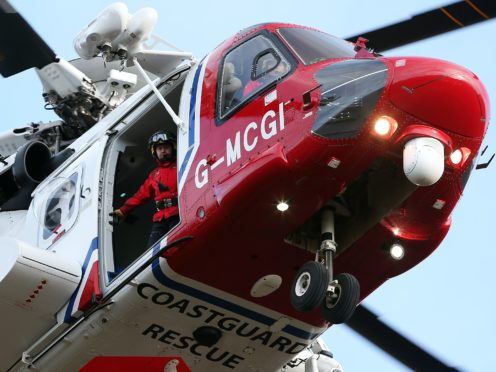A Coastguard helicopter was involved in the rescue (Andrew Milligan/PA)