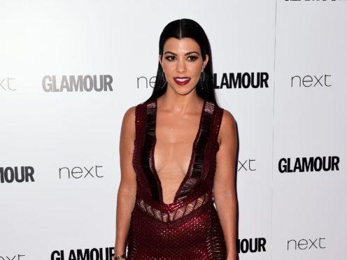 Kourtney Kardashian shared a steamy snap with boyfriend Travis Barker in the couple's latest public display of affection (Ian West/PA)