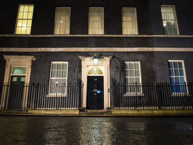 General view of 10 Downing Street, London, in the rain (Dominic Lipinski/PA)