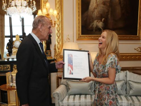 The Duke of Edinburgh with Kylie Minogue (Steve Parsons/PA)