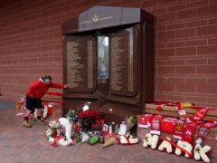 Fans pay their respects at the Hillsborough memorial (Martin Rickett/PA)