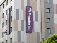 Premier Inn owner Whitbread sank to a £1bn loss in the year of Covid (Steve Parsons/PA)
