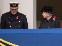 The Queen and Duke of Edinburgh stand on a Foreign Office balcony, overlooking the annual Remembrance Sunday Service at the Cenotaph in Whitehall (Dominic Lipinski/PA)