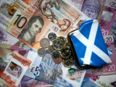 Public sector workers have seen their wages fall by 15% in real terms over the last decade, the STUC said (PA)