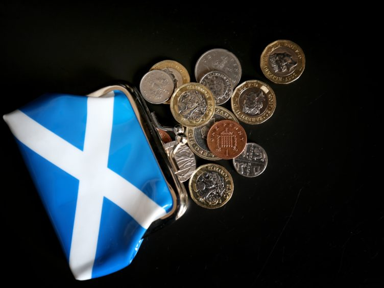 Spending plans for the three largest Scottish parties were analysed (Jane Barlow/PA)